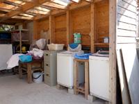 奄美大島のレスト&ロッジ翔 - コテージ側に洗濯機もあり