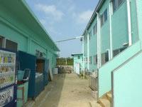 南大東島のプチホテルサザンクロス - 事務所と宿の間が洗濯スペース